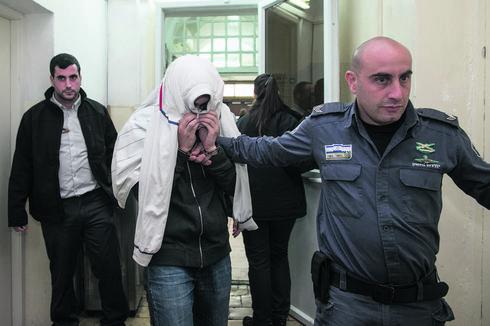 אחד המעורבים בתקיפה בבית המשפט   צילום: אוהד צויגנברג